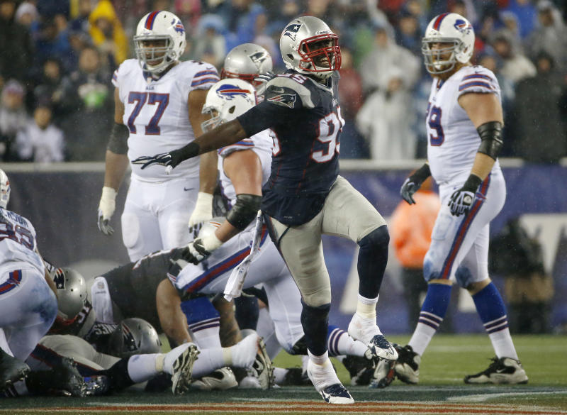 New England Patriots defensive end Chandler Jones (95) celebrates after the Patriots stopped the Buffalo Bills on fourth down during a drive in the second quarter of an NFL football game, Sunday, Dec. 29, 2013, in Foxborough, Mass. (AP Photo/Elise Amendola)