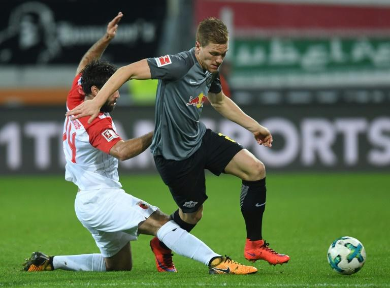 Leipzig's defender Lukas Klostermann (R) and Augsburg's midfielder Jan Moravek (L) vie for the ball during their match in Augsburg, southern Germany, on September 19, 2017