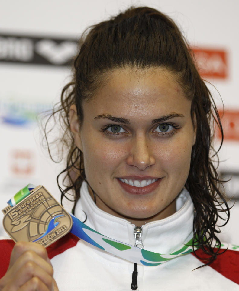 Hungary's Zsuzsanna Jakabos shows off her bronze medal during the ceremony for he Women's 400m Individual Medley during the European Short Course Swimming Championships in Szczecin, Poland, Sunday, Dec. 11, 2011. (AP Photo/Michael Sohn)