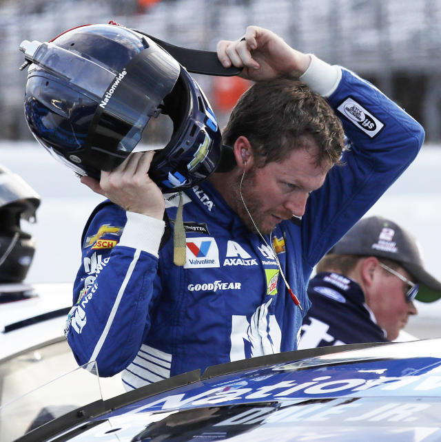 "<a class=""link rapid-noclick-resp"" href=""/nascar/sprint/drivers/88/"" data-ylk=""slk:Dale Earnhardt Jr."">Dale Earnhardt Jr.</a> takes off his helmet after qualifying for the NASCAR Cup Series 300 auto race at New Hampshire Motor Speedway in Loudon, N.H., Friday, Sept. 22, 2017. (AP Photo/Charles Krupa)"