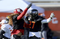 Houston linebacker Grant Stuard of Houston and UCF defensive back Richie Grant of UCF (27) celebrate after an interception during the American team practice for the NCAA college football Senior Bowl, Thursday, Jan. 28, 2021, in Mobile, Ala. (AP Photo/Rusty Costanza)