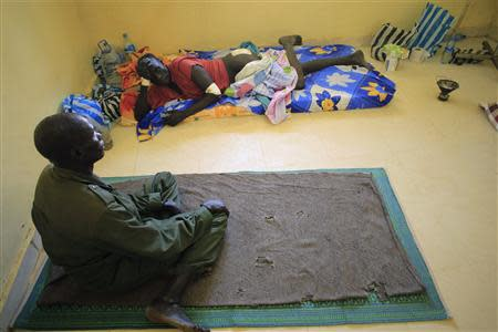 Wounded South Sudan military personnel undergo medical treatment at the general military hospital in the capital Juba December 28, 2013. REUTERS/James Akena