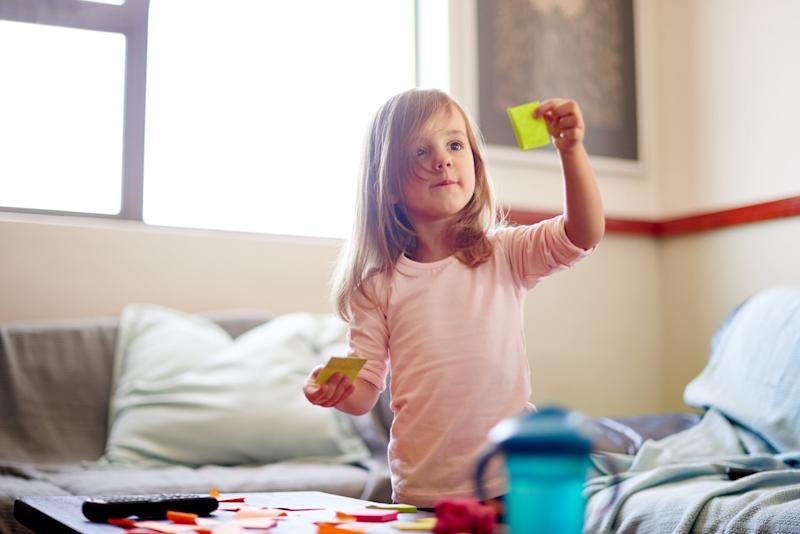 Shot of a little girl playing with sticky notes at homehttp://195.154.178.81/DATA/i_collage/pu/shoots/797389.jpg