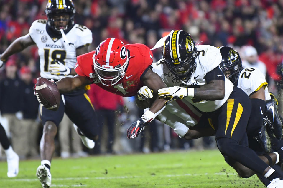 Georgia wide receiver George Pickens dives for a touchdown as Missouri safety Tyree Gillespie (9) defends during the first quarter of an NCAA college football game Saturday, Nov. 9, 2019, in Athens, Ga. (AP Photo/John Amis)