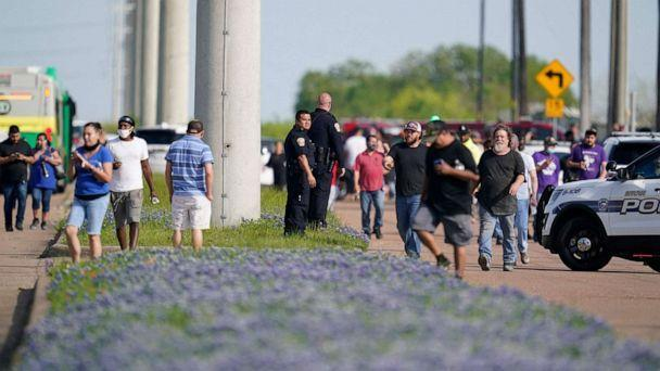 PHOTO: Bryan police officers direct workers away from the scene of a mass shooting at an industrial park in Bryan, Texas, April 8, 2021. (Sam Craft/AFP via Getty Images)