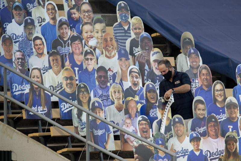 LOS ANGELES, CA - SEPTEMBER 01: An Major League Baseball authenticator puts stickers on the cutouts at Dodger Stadium Sep. 1, 2020, in Los Angeles. (Photo by Kyusung Gong/Icon Sportswire via Getty Images)
