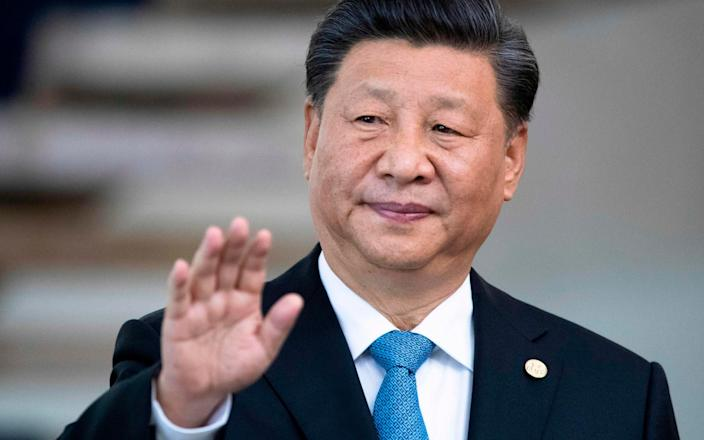 Xi Jingping, China's leader, gestures at a press conference - AFP