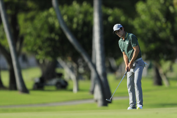 Joaquin Niemann, of Chile, reacts after missing a putt on the 12th green during the first round of the Sony Open golf tournament Thursday, Jan. 14, 2021, at Waialae Country Club in Honolulu. (AP Photo/Jamm Aquino)