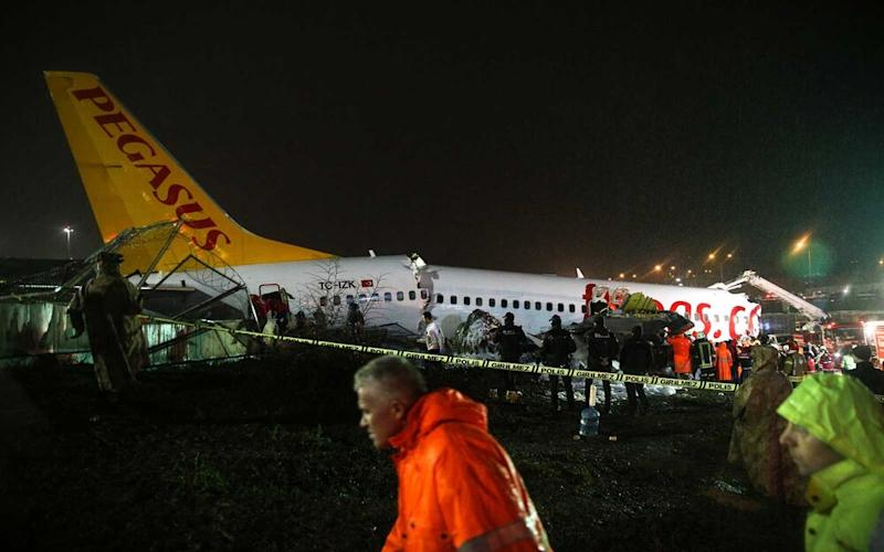 A view of the site as firefighters, paramedics conducting operations and injured passengers are being dispatching to hospitals after a passenger plane skidded off the runway in Istanbul Sabiha Gokcen International Airport, breaking into two, on February 05, 2020 in Istanbul, Turkey. (   Anadolu Agency/Getty Images