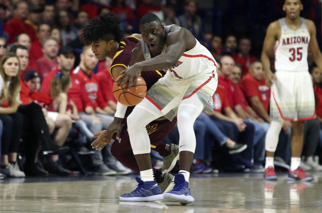 "Arizona State guard Remy Martin, left, reaches to steal the ball from Arizona guard <a class=""link rapid-noclick-resp"" href=""/ncaab/players/136216/"" data-ylk=""slk:Rawle Alkins"">Rawle Alkins</a> (1) during the first half of an NCAA college basketball game, Saturday, Dec. 30, 2017, in Tucson, Ariz. (AP Photo/Ralph Freso)"