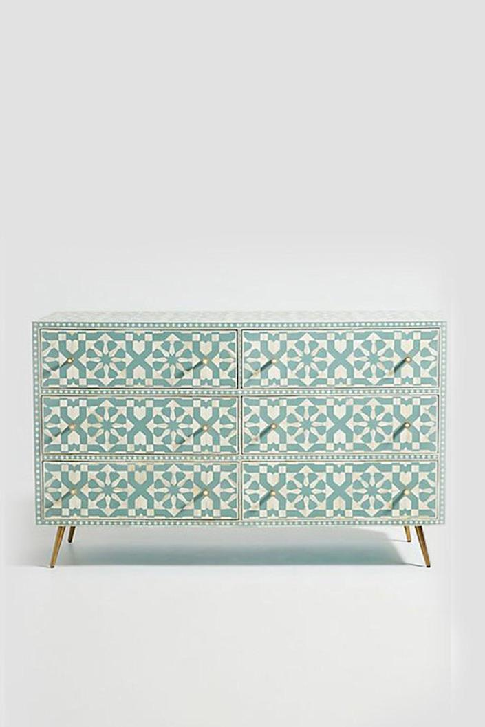 """This intricate six-drawer chest boasts incredible attention to detail—especially when it comes to the Moroccan-style pattern. Complete with hand-carved bone inlay that's been sanded down to create a super-smooth finish, this colorful dresser is sure to be a conversation starter. $2160, Etsy. <a href=""""https://www.etsy.com/listing/903288371/bone-inlay-moroccan-design-6-drawers?"""" rel=""""nofollow noopener"""" target=""""_blank"""" data-ylk=""""slk:Get it now!"""" class=""""link rapid-noclick-resp"""">Get it now!</a>"""