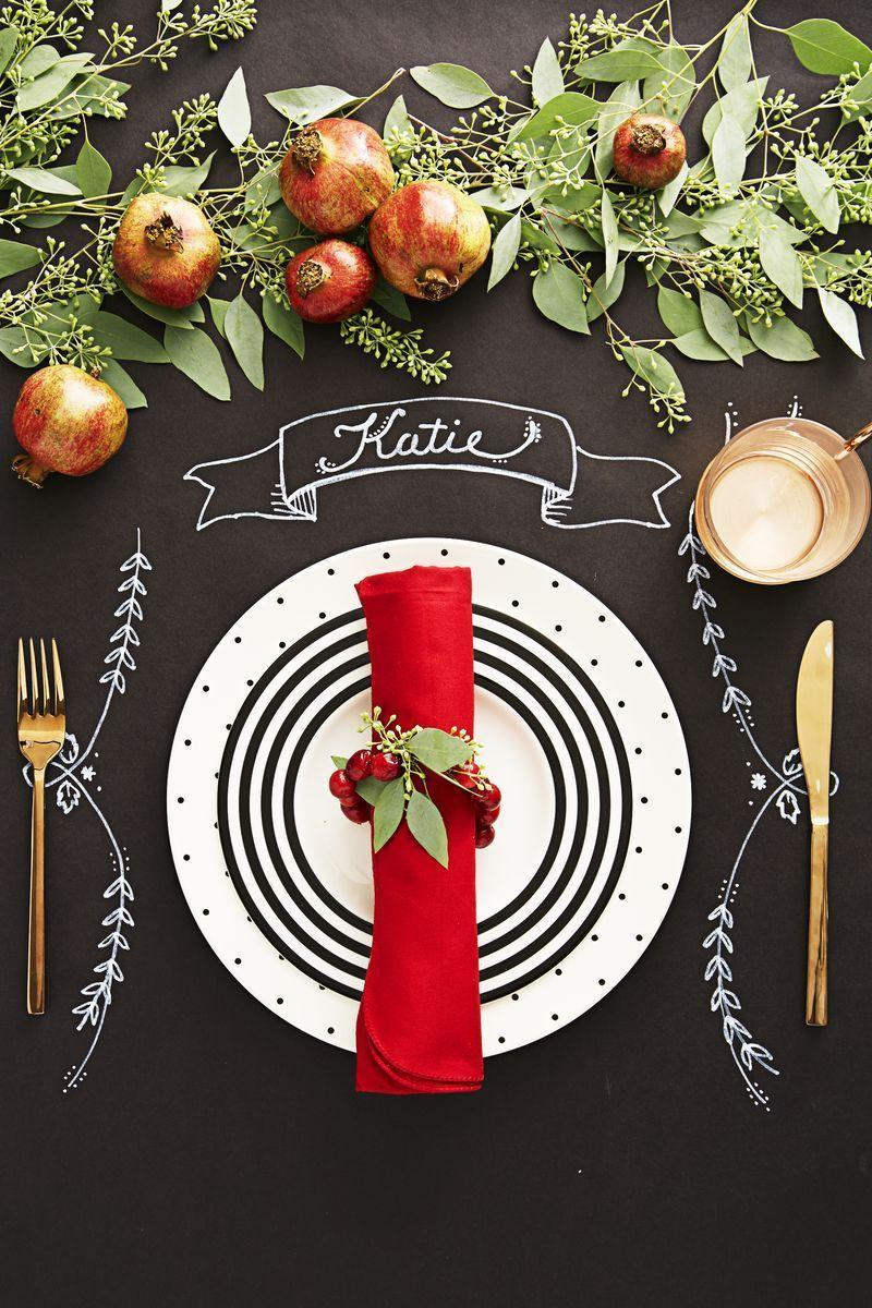 <p>Use chalkboard paper for your tablecloth, and write the names of guests above the plates. Make napkin rings by stringing cranberries on a thin wire, tying it into a circle with a sprig of eucalyptus.</p>
