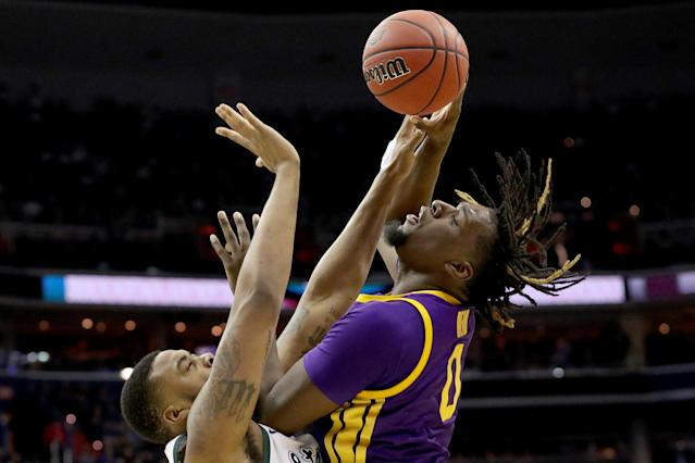 <p>Naz Reid #0 of the LSU Tigers is defended by Nick Ward #44 of the Michigan State Spartans during the second half in the East Regional game of the 2019 NCAA Men's Basketball Tournament at Capital One Arena on March 29, 2019 in Washington, DC. (Photo by Patrick Smith/Getty Images) </p>