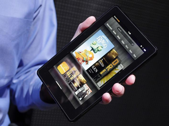 FILE - In this Sept. 28, 2011 file photo, the Kindle Fire is displayed at a news conference, in New York. Apple has successfully fended off competitors who have tried to sell tablets in iPad's size range. But last year, Amazon.com Inc. figured out how to crack Apple's stranglehold on tablets by making a half-size, no-frills tablet. The result was the Kindle Fire, which sells for $199 -basically, the cost of production. Amazon has sold millions of them. (AP Photo/Mark Lennihan, File)
