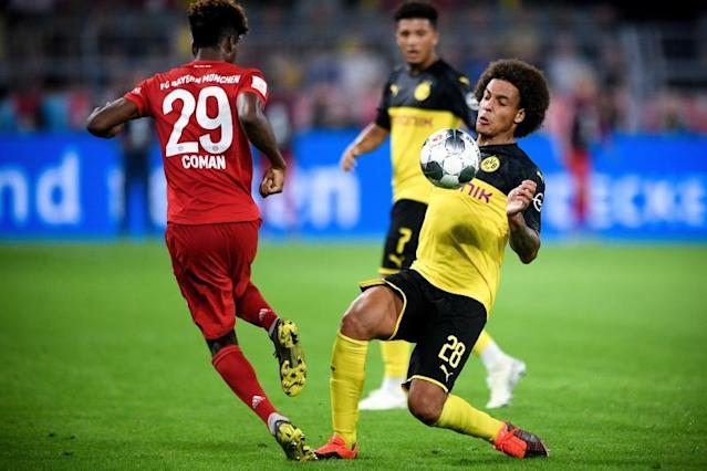 Dortmund's Axel Witsel (R) in action against Bayern's Kingsley Coman (L) during the German Supercup soccer match between Borussia Dortmund and FC Bayern Muenchen in Dortmund, Germany, 03 August 2019. (Alemania, Rusia) EFE/EPA/SASCHA STEINBACH CONDITIONS - ATTENTION: The DFL regulations prohibit any use of photographs as image sequences and/or quasi-video.