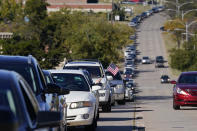Cars line the street outside the Oklahoma County Election Board for early voting Thursday, Oct. 29, 2020, in Oklahoma City. (AP Photo/Sue Ogrocki)