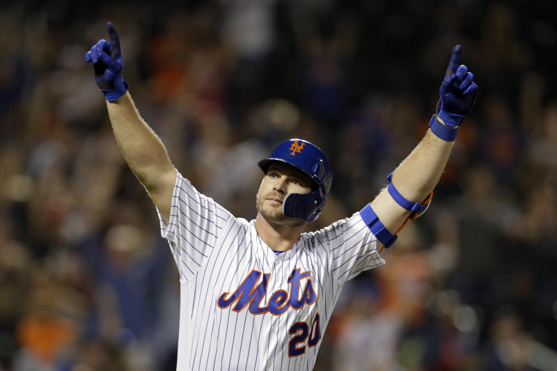 FILE - In this Sept. 28, 2019, file photo, New York Mets' Pete Alonso reacts after hitting a home run during the third inning of a baseball game against the Atlanta Braves, in New York. Mets first baseman Pete Alonso and Houston Astros slugger Yordan Álvarez have been picked as this year's top rookies by Baseball Digest. (AP Photo/Adam Hunger, File)