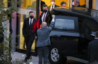 White House national security adviser Jake Sullivan, left, and his delegation leave a hotel in Zurich, Switzerland, Switzerland where a meeting between US and Chinese officials was taking place on Wednesday Oct. 6, 2021. Top diplomatic advisers to U.S. President Joe Biden and Chinese President Xi Jinping have been holding several hours of talks in Switzerland's largest city in hopes of ironing out differences on a range of topics from trade to Taiwan. White House national security adviser Jake Sullivan and senior Chinese foreign policy adviser were holding extended meetings a hotel near Zurich's airport. (Michael Buholzer/Keystone via AP)