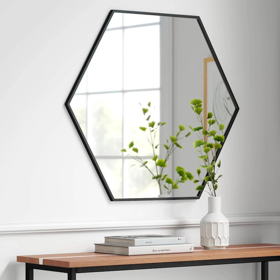"""<p>The <span>Project 62 30"""" x 26"""" Metal Hexagon Mirror MDF Back</span> ($60) is a modern and sleek vanity mirror that will compliment your glam station.</p>"""