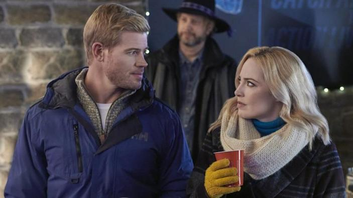 "Two for the Win -- Hallmark TV Movie A world champion ski racer and local ski instructor find romance on the slopes as he returns home and prepares for the biggest race of his life. Photo: Trevor Donovan, Charlotte Sullivan Credit: ©2021 Crown Media United States LLC/Photographer: Albert Camicioli Trevor Donovan and Charlotte Sullivan in ""Two for the Win"" on Hallmark."