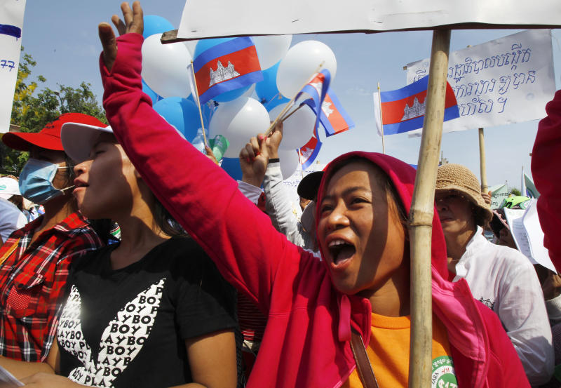 FILE - In this May 1, 2015, file photo, garment workers shout slogans during a gathering to mark May Day celebrations in Phnom Penh, Cambodia. Cambodia's government announced Friday it is raising the minimum wage for the garment industry, the country's biggest export earner, whose workers make up a powerful political bloc. (AP Photo/Heng Sinith, File)