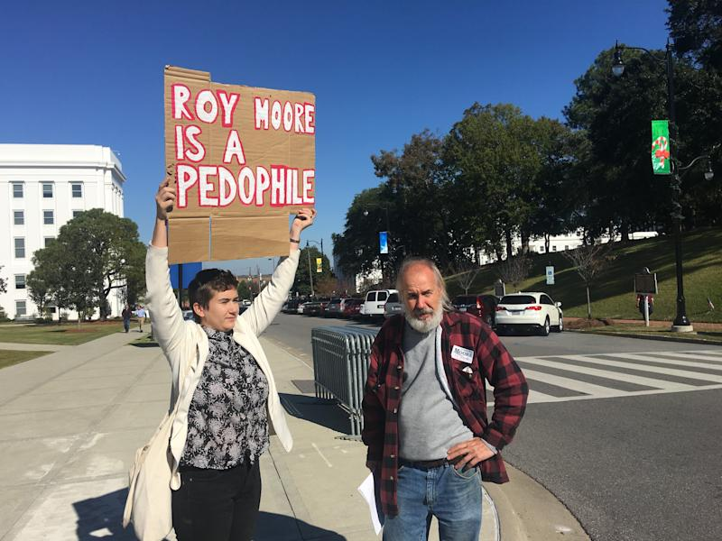 Tim Hensley, at right, argues with a protester at the Roy Moore event on Friday.