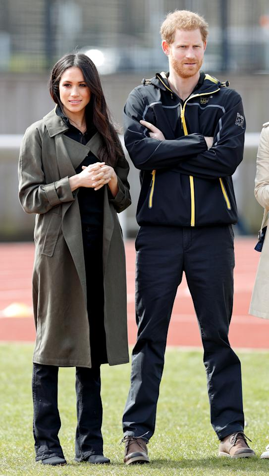 <p>Meghan Markle wears a classic trench coat by Aritzia while attending the UK Team Trials for the Invictus Games with Prince Harry in Bath, England. (Photo by Karwai Tang/WireImage) </p>