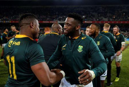 Rugby Union - Second Test International - South Africa v England - Free State Stadium, Bloemfontein, South Africa - June 16, 2018. South Africa's captain Siya Kolisi congratulates his team mates after they won against England. REUTERS/Siphiwe Sibeko