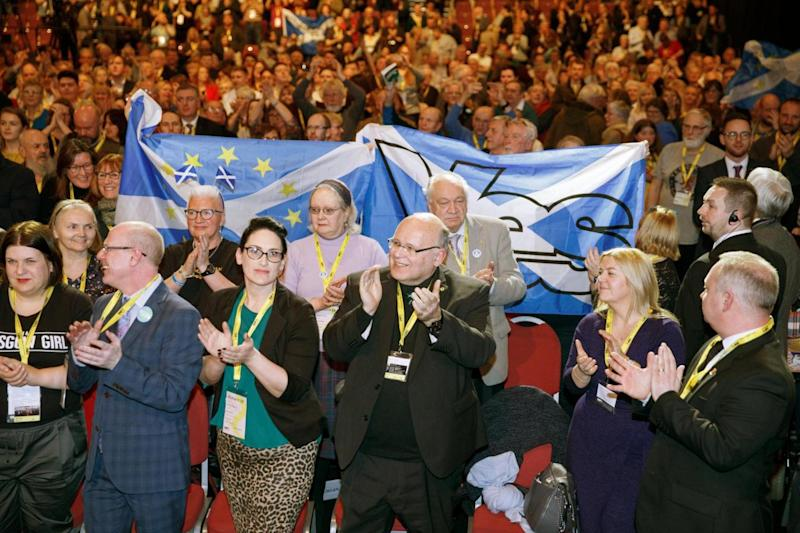 Supporters applaud Ms Sturgeon at the SNP party conference (EPA)