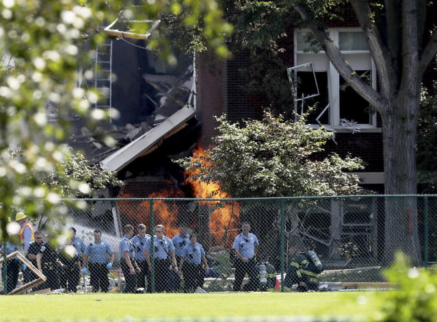 <p>Emergency personnel move away as a gas fire continues to burn following an explosion at Minnehaha Academy Aug. 2, 2017, in Minneapolis. Several people are unaccounted for after an explosion and partial building collapse Wednesday at a Minneapolis school, fire officials said. (David Joles/Star Tribune via AP) </p>