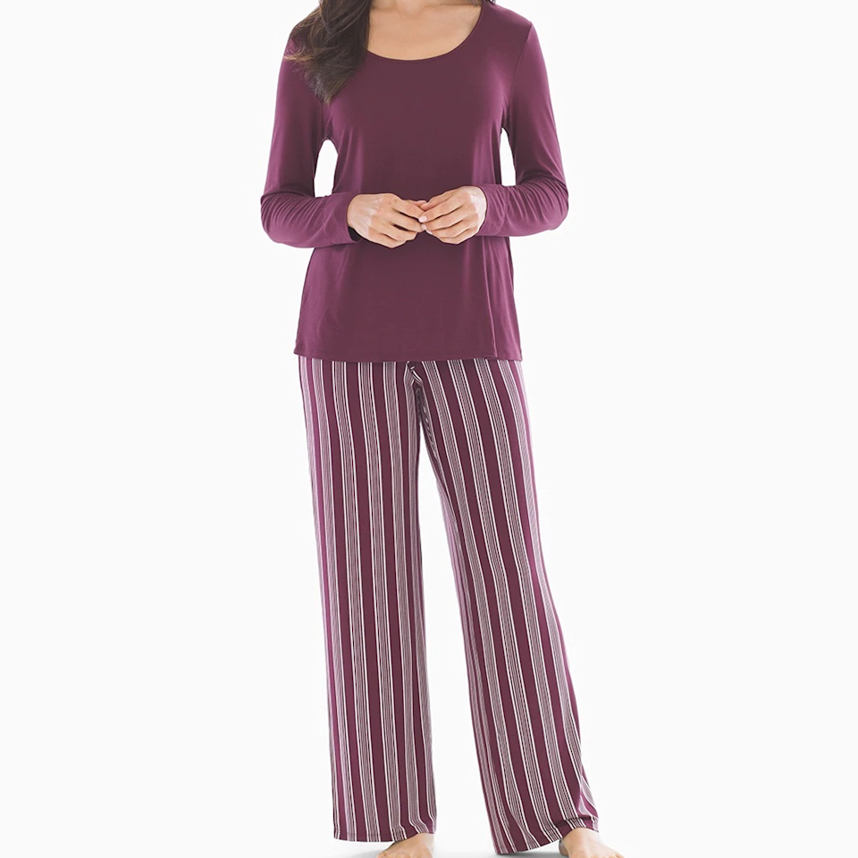 """<p>You may already know that Soma makes some of the most supportive, pretty, and — most importantly — comfortable bras out there, but if you haven't discovered the brand's pajama sets, you don't know just how comfortable Soma can make you. The Cool Nights sets feature solid-color, long-sleeve tees and patterned pants that come in regular, short, and long inseams, so you'll never get caught with cold ankles or tripping over the hems. There are a variety of combinations available, but we especially love this Noble Stripe Merlot set.</p> <p><strong>$49</strong> (<a href=""""https://www.soma.com/store/category/pajama+sets/cat12679307/"""" rel=""""nofollow"""">Shop Now</a>)</p>"""