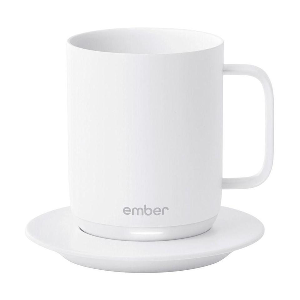 """<p><strong>Ember</strong></p><p>amazon.com</p><p><strong>$99.95</strong></p><p><a href=""""https://www.amazon.com/dp/B07NQRM6ML?tag=syn-yahoo-20&ascsubtag=%5Bartid%7C2089.g.2100%5Bsrc%7Cyahoo-us"""" rel=""""nofollow noopener"""" target=""""_blank"""" data-ylk=""""slk:Shop Now"""" class=""""link rapid-noclick-resp"""">Shop Now</a></p><p>If their coffee gets cold faster than they can consume it, consider gifting them this <a href=""""http://www.bestproducts.com/lifestyle/a32041115/ember-mug-review/"""" rel=""""nofollow noopener"""" target=""""_blank"""" data-ylk=""""slk:temperature-controlled mug"""" class=""""link rapid-noclick-resp"""">temperature-controlled mug</a> that can keep drinks hot and ready for sipping long after they've been poured. </p><p>It'll save them several trips to the microwave and maybe even some cash, since they'll be more inclined to make coffee at home!</p>"""