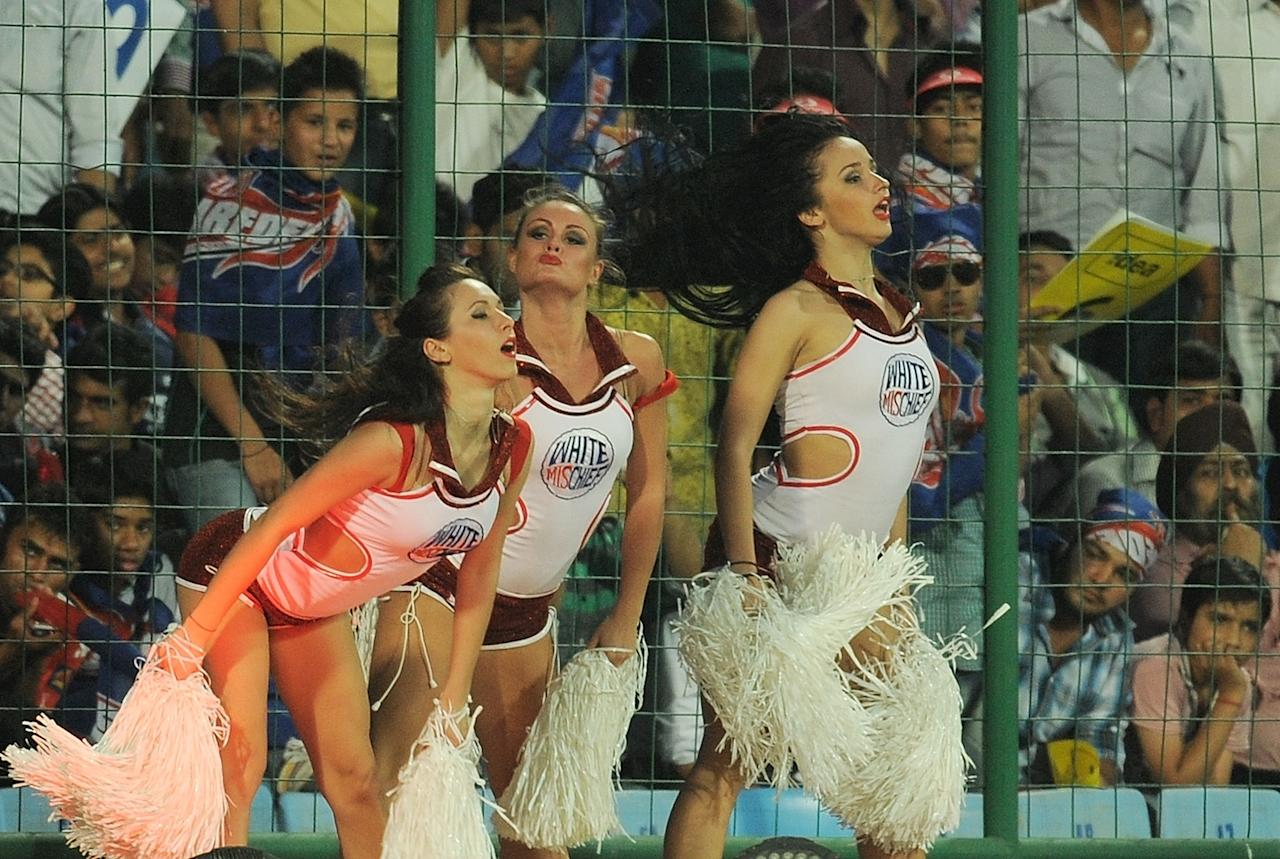 Delhi Daredevils cheerleaders perform during the IPL Twenty20 cricket match between Deccan Chargers and Delhi Daredevils at The Feroz Shah Kotla stadium in New Delhi on April 19, 2012. RESTRICTED TO EDITORIAL USE. MOBILE USE WITHIN NEWS PACKAGE. AFP PHOTO/ MANAN VATSYAYANA (Photo credit should read MANAN VATSYAYANA/AFP/Getty Images)