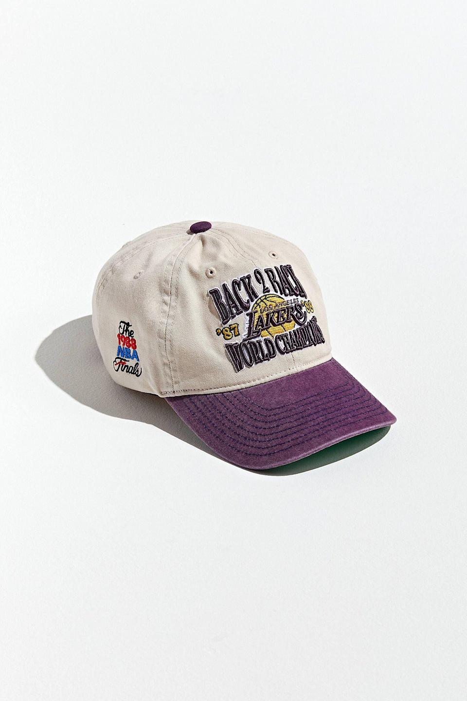 """<p><strong>Mitchell & Ness x UO Exclusive</strong></p><p>urbanoutfitters.com</p><p><strong>$36.00</strong></p><p><a href=""""https://go.redirectingat.com?id=74968X1596630&url=https%3A%2F%2Fwww.urbanoutfitters.com%2Fshop%2Fmitchell-and-ness-uo-exclusive-la-lakers-back-to-back-champs-baseball-hat&sref=https%3A%2F%2Fwww.countryliving.com%2Fshopping%2Fgifts%2Fg24168813%2Fboyfriend-gift-ideas%2F"""" rel=""""nofollow noopener"""" target=""""_blank"""" data-ylk=""""slk:Shop Now"""" class=""""link rapid-noclick-resp"""">Shop Now</a></p><p>Basketball-loving boyfriends will go wild for this vintage-inspired Lakers hat.</p>"""
