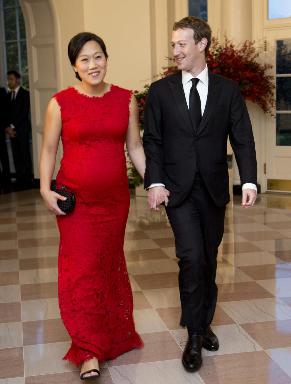 <p>Facebook Chairman and Chief Executive Officer Mark Zuckerberg was one of the many distinguished guests along with his pregnant wife, Priscilla Chan. The Bay Area-based doctor, who recently watched from front row at Rebeca Minkoff's tech-infused runway show, wore a red lace gown with a crew neck. </p>
