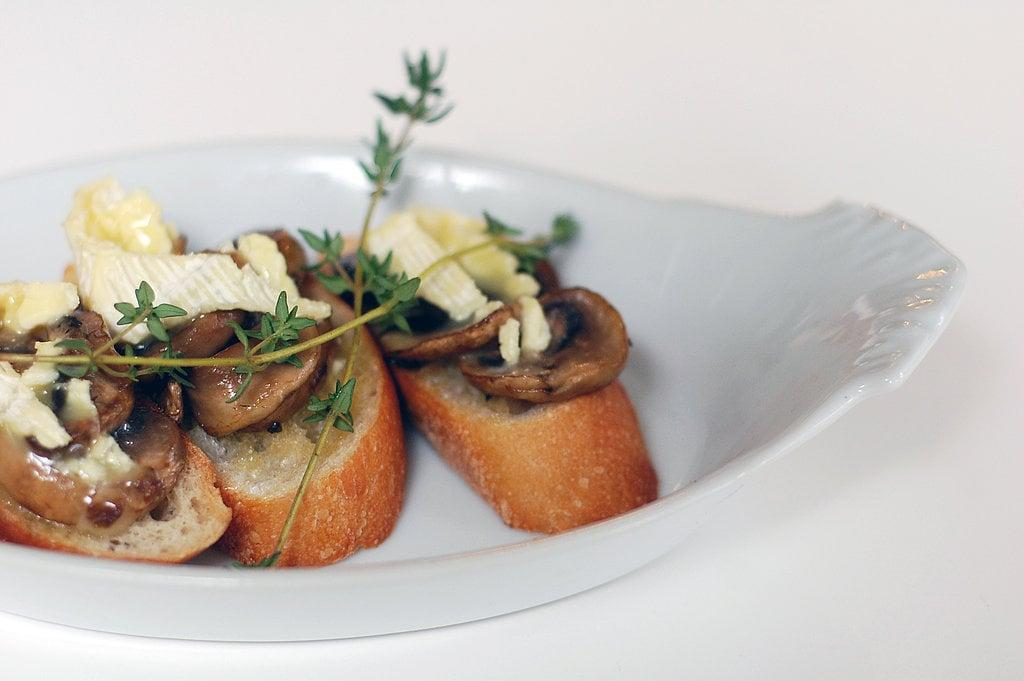 "<p>Fresh thyme - a lot of it - is a key component in <a href=""https://www.popsugar.com/food/Mushroom-Brie-Bruschetta-20509078"" class=""ga-track"" data-ga-category=""Related"" data-ga-label=""http://www.yumsugar.com/Mushroom-Brie-Bruschetta-20509078"" data-ga-action=""In-Line Links"">mushroom and brie bruschetta</a>. It's fitting for a Fall dinner because it's both rustic and elegant at the same time.</p>"