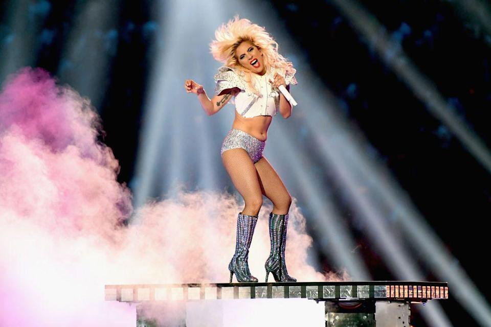 <p>For her second ensemble, the actor and singer changed into an American football-inspired top and hot pants.</p>