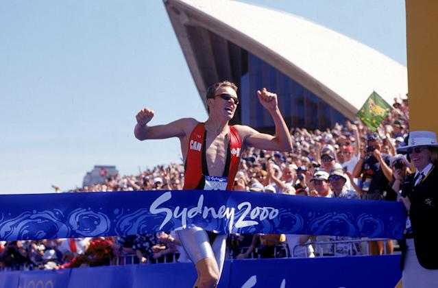 17 Sep 2000: Simon Whitfield of Canada crosses the finish line to win the Gold Medal in the Mens Triathlon during the 2000 Sydney Olympic Games at the Opera House in Sydney, Australia. Mandatory Credit: Adam Pretty/AUS /Allsport