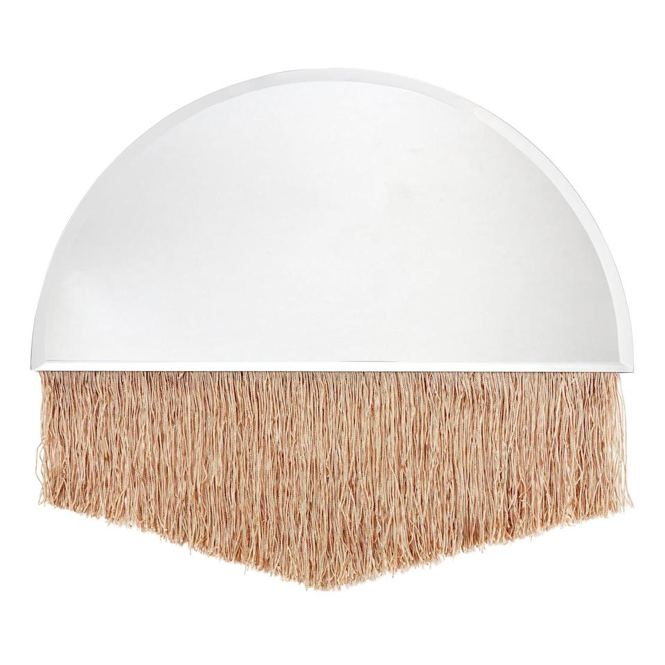 <p>This <span>Drew Barrymore Flower Home Arch Bevel Glass Mirror with Fringe</span> ($40) is so unique.</p>