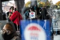 Voters line up to cast ballots on the first day of early voting in New York