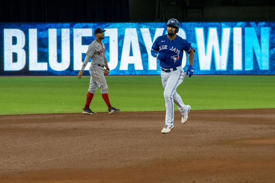 Aug 7, 2021; Toronto, Ontario, CAN; Toronto Blue Jays shortstop Marcus Semien (10) hits a walk off home run against the Boston Red Sox during the seventh inning at Rogers Centre. Mandatory Credit: Kevin Sousa-USA TODAY Sports