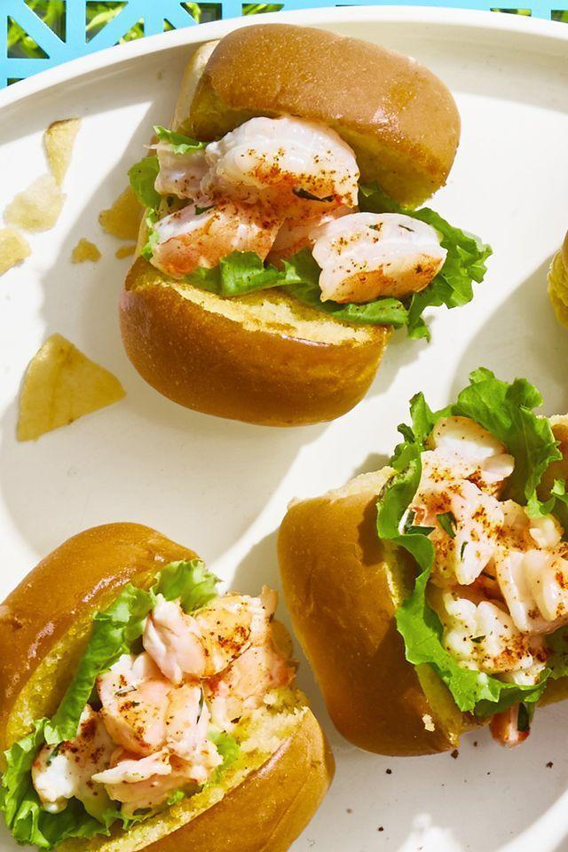 """<p>These sweet little shrimp rolls are two bites (max), which means you can eat a few without feeling any guilt. </p><p><em><a href=""""https://www.goodhousekeeping.com/food-recipes/a21605904/mini-shrimp-rolls-recipe/"""" rel=""""nofollow noopener"""" target=""""_blank"""" data-ylk=""""slk:Get the recipe for Mini Shrimp Rolls »"""" class=""""link rapid-noclick-resp"""">Get the recipe for Mini Shrimp Rolls »</a></em></p>"""