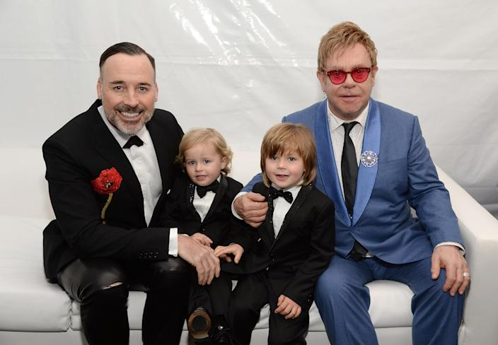 Elton John is loving staying at home with sons Elijah and Zachary and husband David Furnish. (Getty Images for EJAF)