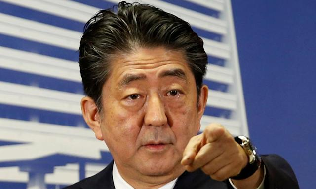 "<span class=""element-image__caption"">Japan's Prime Minister Shinzo Abe has won a landslide victory in the country's general election.</span> <span class=""element-image__credit"">Photograph: Toru Hanai/Reuters</span>"