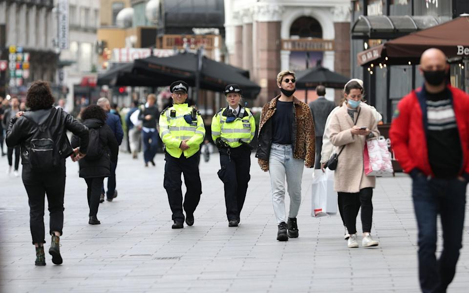 Police officers on patrol in Leicester Square, London. Mayor of London Sadiq Khan has announced that London will be moved to Tier 2 coronavirus restrictions from midnight on Friday. - Yui Mok/PA