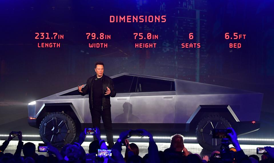 Tesla co-founder and CEO Elon Musk discusses vehicle dimensions in front of the newly unveiled all-electric battery-powered Tesla Cybertruck at Tesla Design Center in Hawthorne, California on November 21, 2019. (Photo by Frederic J. BROWN / AFP) (Photo by FREDERIC J. BROWN/AFP via Getty Images)