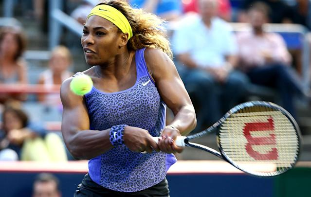 Serena Williams returns a shot to Samantha Stosur during their Rogers Cup match in Montreal on August 6, 2014 (AFP Photo/Streeter Lecka)