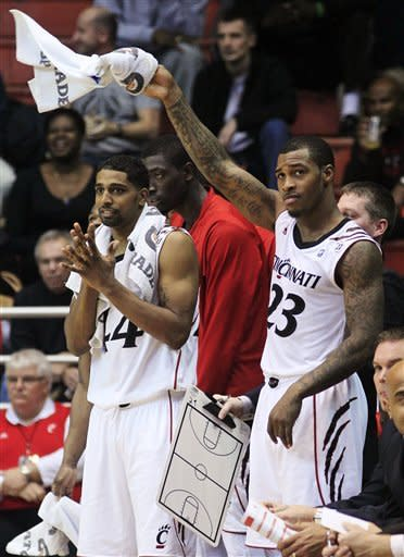 Cincinnati's Sean Kilpatrick (23) and guard JaQuon Parker (44) cheer for their teammates in the closing seconds of their 102-60 win over Mississippi Valley State in an NCAA college basketball game, Tuesday, Nov. 13, 2012, in Cincinnati. Kilpatrick led Cincinnati with 20 points and eight rebounds. (AP Photo/Al Behrman)