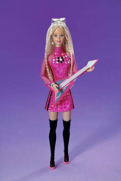 <p>Lead Singer Barbie puts a '90s spin on her rock-and-roll look, with a high-necked mesh-sleeved mini and thigh-high boots.</p>