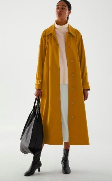 <p>Mix this oversized trench with other autumnal pieces for the perfect fall look.</p> <p><span>COS Organic Cotton Oversized Trench Coat</span> ($250) </p>